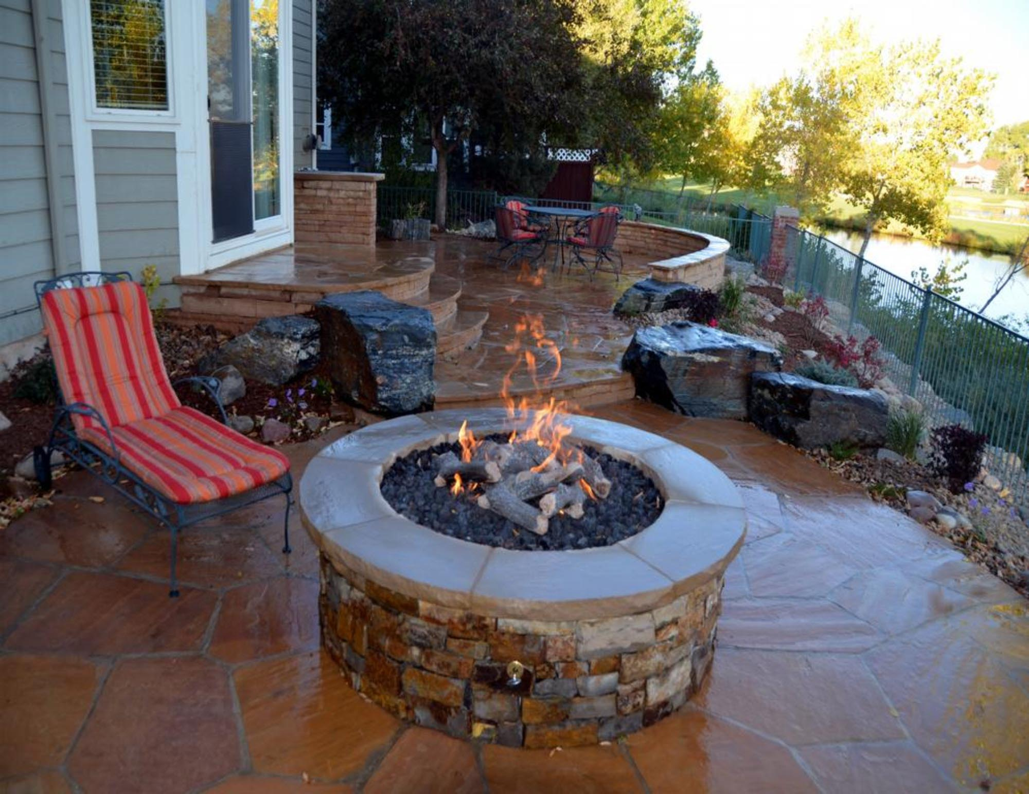 Outdoor fire pit designs patios fire pit design ideas for Backyard rock fire pit ideas