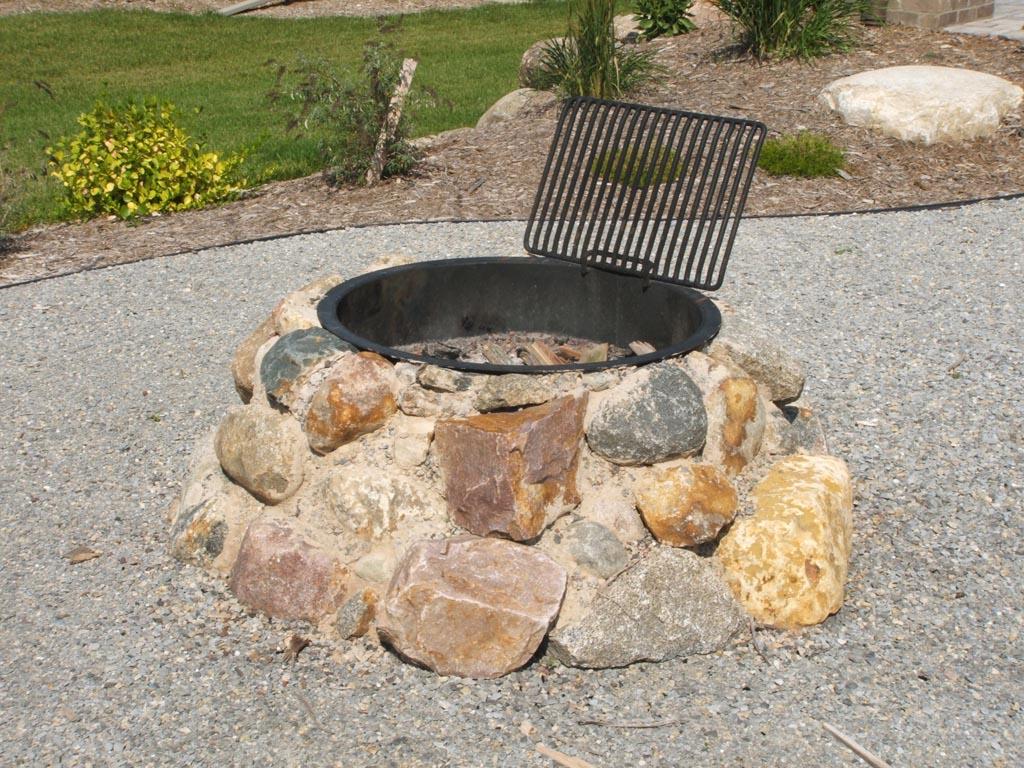 Stone fire pit construction fire pit design ideas for Outdoor fire pit construction