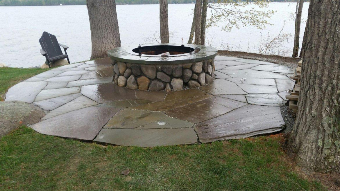 Stone veneer fire pit fire pit design ideas for How to build a river rock patio