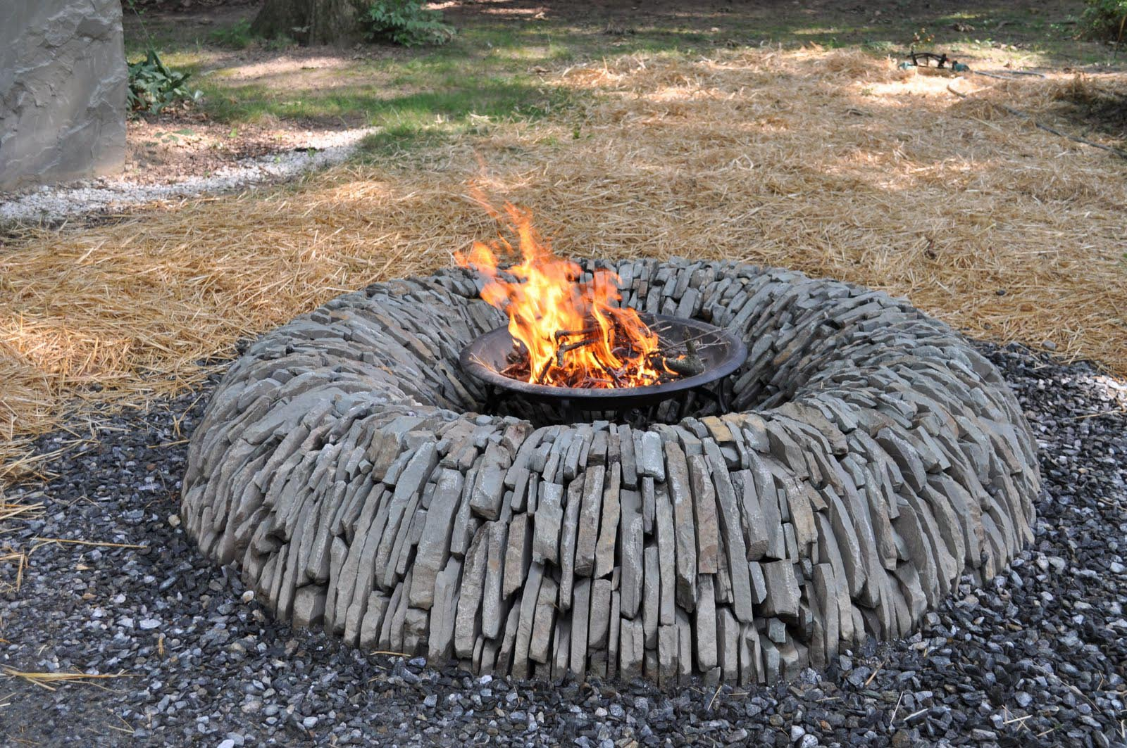 Homemade stone fire pit fire pit design ideas for Backyard rock fire pit ideas